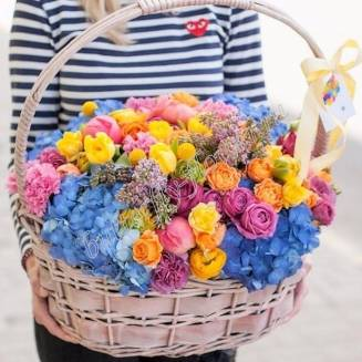 Large bouquet of spring flowers in basket