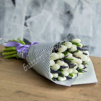 Bouquet of 29 white tulips and lavender in craft