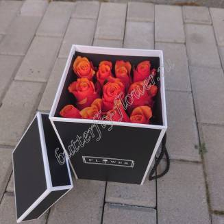 """Bouquet of 11 orange roses in a black design box """"Fiery flashes"""""""