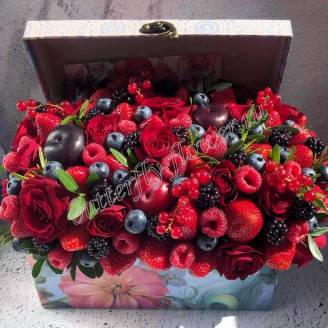 "Food bouquet of berries of strawberries, raspberries, blueberries, currants, plums and roses in the decorative chest ""Pirate Treasure"""